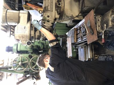 George drills a new shim ready to fit under the axlebox brass.