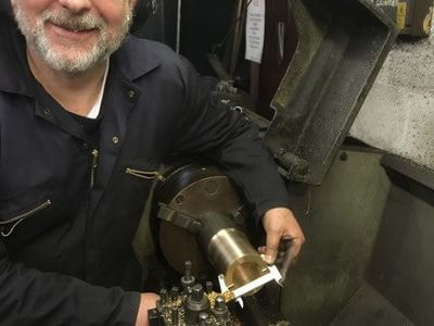 Nigel looking pleased with another one of the many motion bushes being made to replace the worn existing ones.