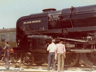 22nd June 1974. Black Prince 92203 receiving some attention from Harry Frith and friend on a lovely summers day at Cranmore. Also in the picture are George Davies and Colin Saunders