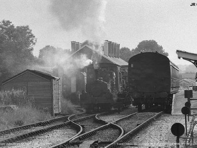 Lord Fisher steams out of the shed yard with a pway train 1985