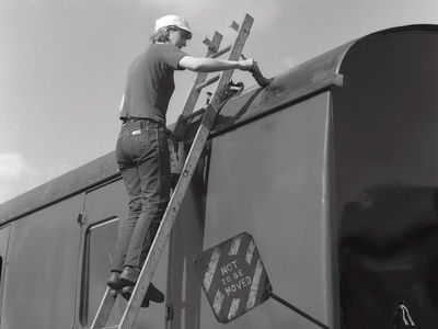 Denise Mogg at work on the roof of Mk 1 coach. 7th Sept 1985.