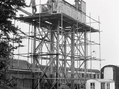 23rd July 1985.The end of an era - the old water tank that served the railway since 1973 is being dismantled and replaced by one of fully welded construction. A number of the old panels were later reused for another water tank.