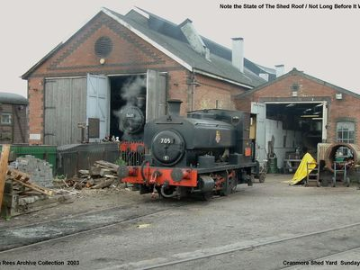 A view of the Cranmore shed yard ( Cranmore End ) with 5637 in steam just visible in the shed doorway and 705 parked up on the workshop road but take a look at the state of the shed roof not long before it was replaced. Picture taken Sunday 1st June 2003