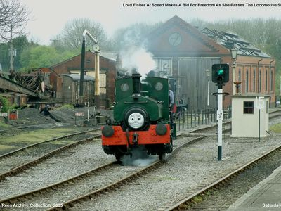 Just another day at Cranmore when Lord Fisher makes a bid for freedom as she passes the locomotive shed at speed. Picture taken Saturday 30th April 2005.
