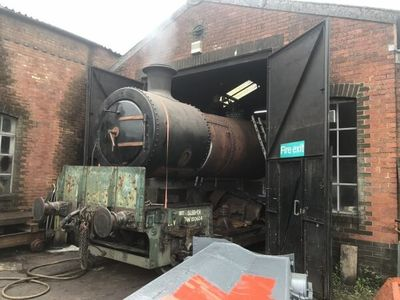 The boiler is pulled out of the workshop for the steam tests.