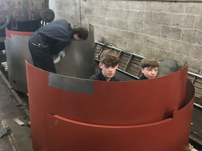 Jake, Jacob and Louis prepare and paint the new cladding sections.