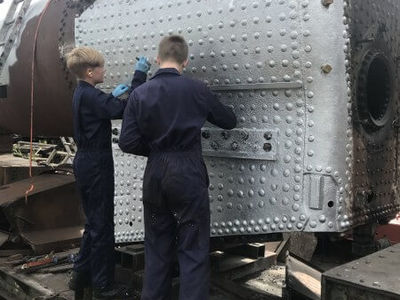 Jack and his brother Tom applying the boiler paint.