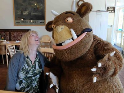 Gruffalo shares a joke with one of our visitors in the cafe