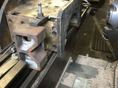 One of the trailing axleboxes is set up on the milling machine ready for machining.