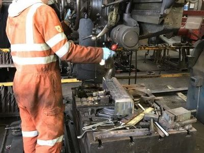 Edd drills the new tank brackets to allow the injector delivery pipes clearance to pass through.