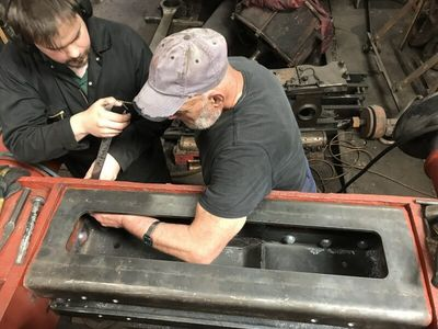 Keith and Elliot bolt in the top section of the dragbox having just riveted the lower section. These bolts then get replaced with rivets too.