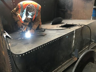 Jeff welding in the coal plate into the bunker.