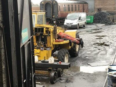 Not all jobs are glamorous. Whilst all this other work was happening in the comfort of the workshop, Edd was giving the digger some much needed maintenance outside in the bad weather!