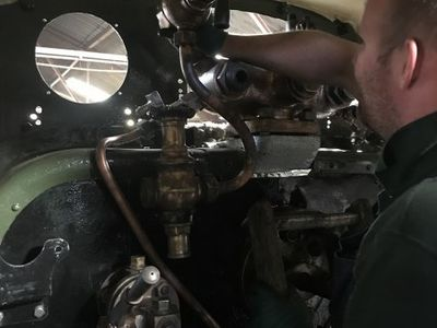 Chris fits the  steam heat valve to the manifold.