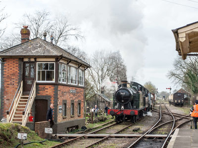 The Ivatt steams past the signal box